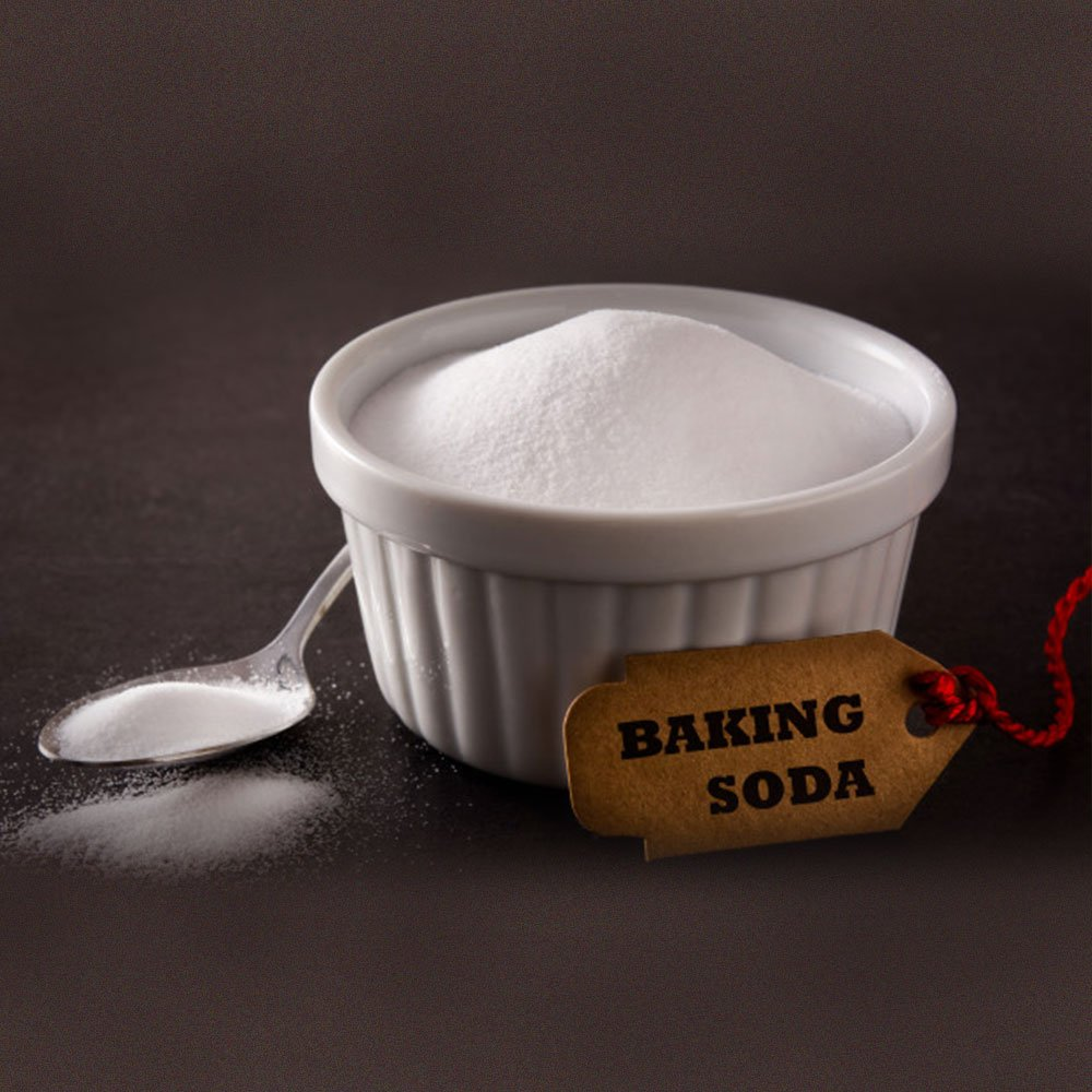 baking soda powder on spoon and blow
